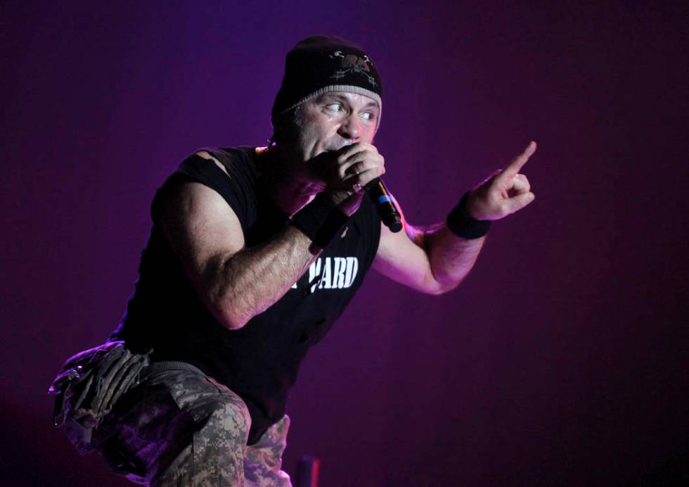 In this photo taken Saturday, Aug. 14, 2010, singer Bruce Dickinson of Iron Maiden performs at ...