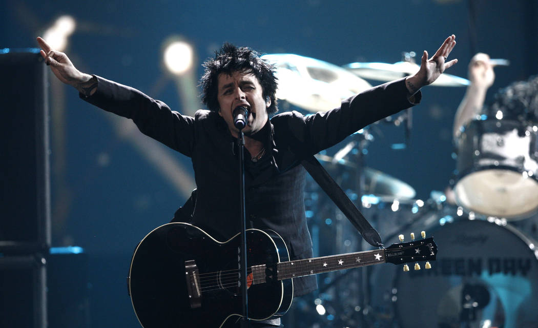 Billie Joe Armstrong, from Green Day, performs at the 37th Annual American Music Awards on Sun ...