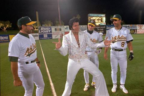 """An Elvis Presley impersonator who identified himself only as """"Reno"""" demonstrates a fe ..."""
