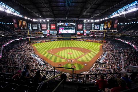 Fans watch the action during an Arizona Diamondbacks baseball game against the Philadelphia Phi ...