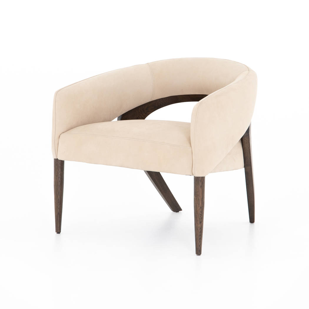 The Atlas Chair from Four Hands comes in nubuck sand with brown oak framing that curves into ex ...
