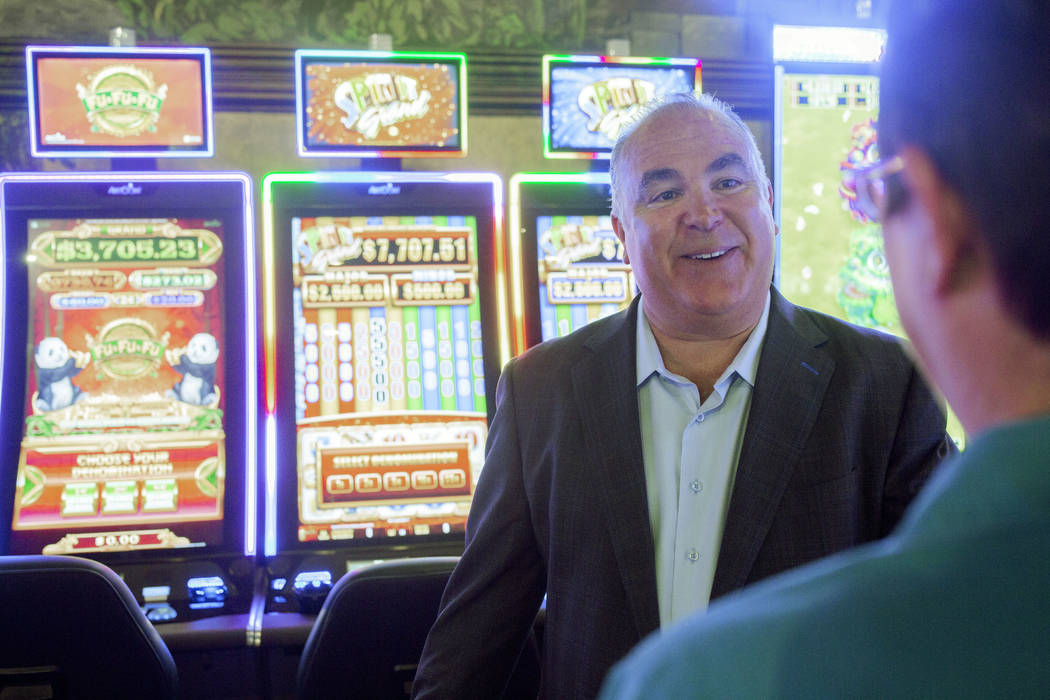 Emerald Island Casino Owner Tim Brooks speaks with shift manager Sharon Opsta inside of the Eme ...