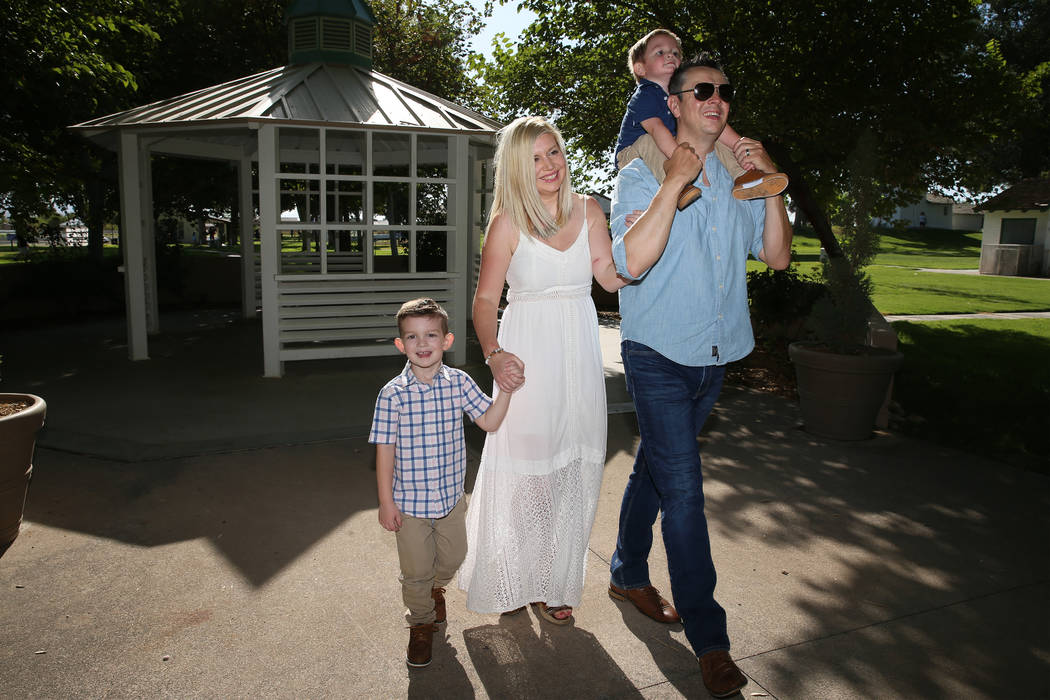 Charlie Bayley, second from left, with her son Logan, left, and husband Steve, with her son Noa ...