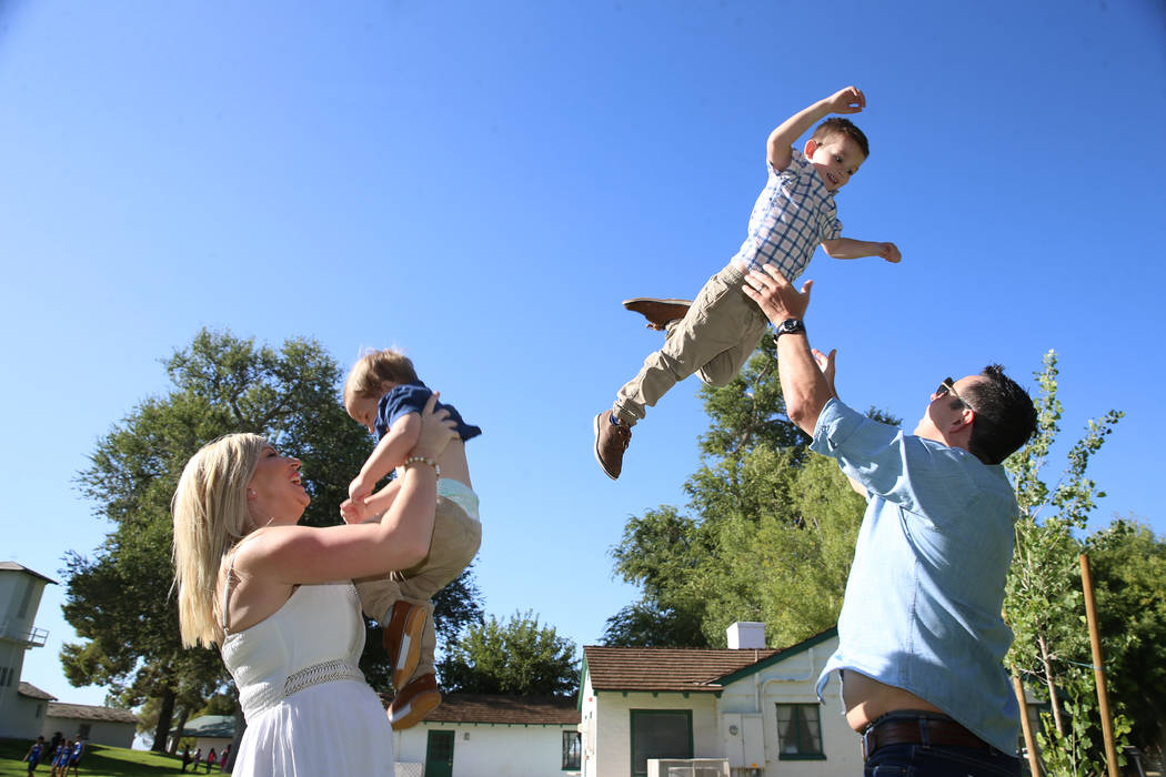 Charlie Bayley, from left, with her son Noah, 1, and husband Steve, with her son Logan, 4, play ...