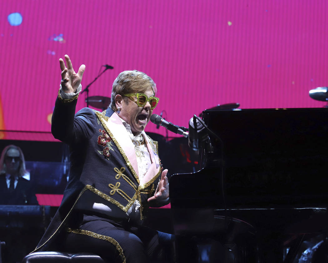 """Elton John performs onstage during his """"Farewell Yellow Brick Road"""" final tour at Mad ..."""