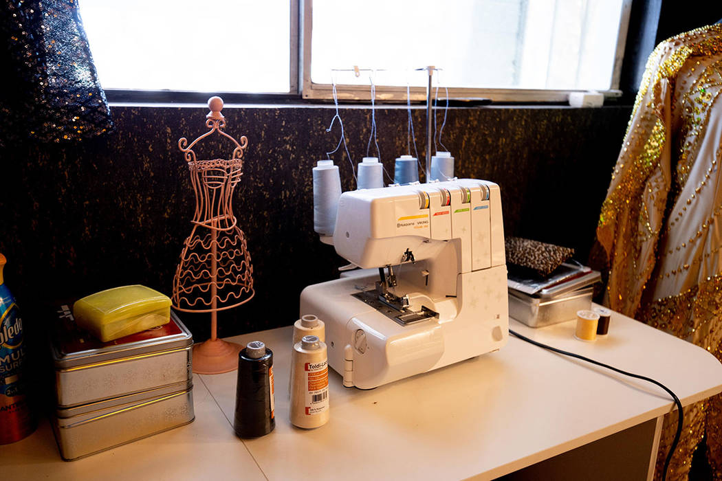 "A small sewing machine sits on a table in the ""drag room"" of Mark Hooker's remodeled home. (Ton ..."