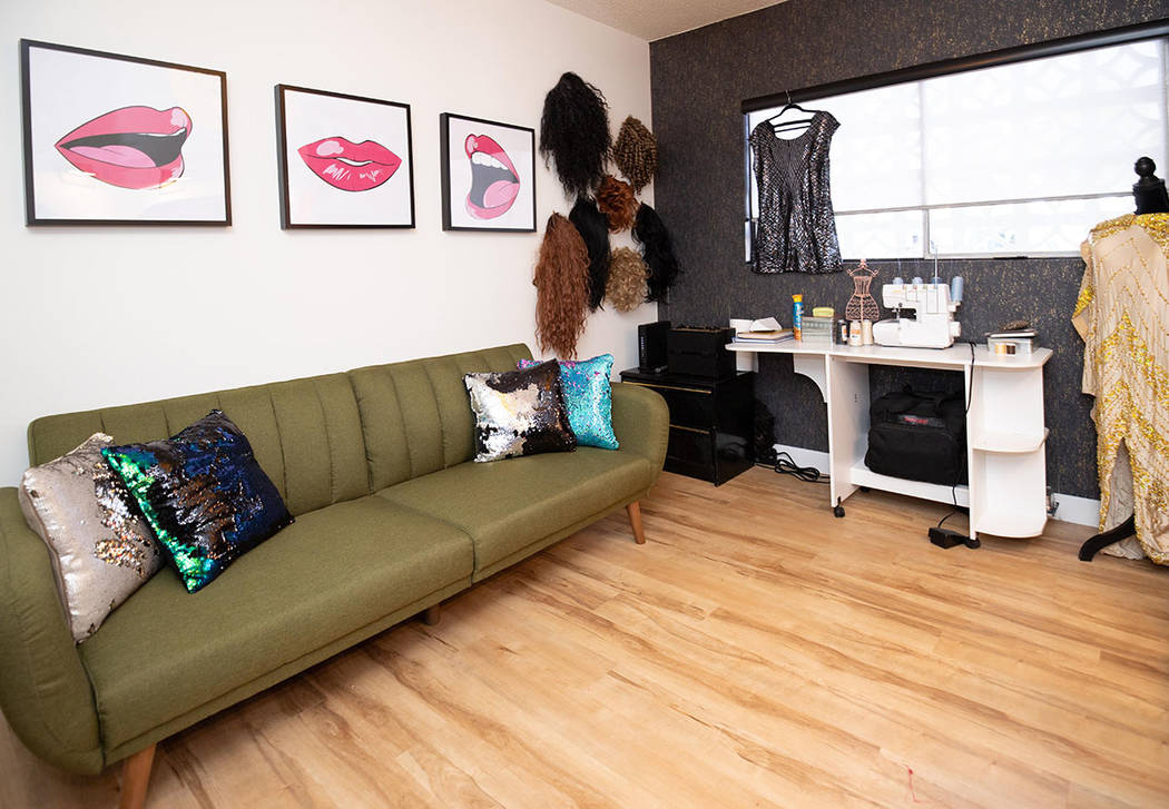 "One of the bedrooms was converted into this ""drag room"" to store costumes and wigs. (Tonya Harv ..."