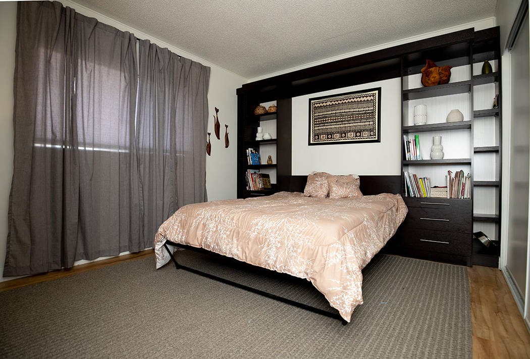 The master bedroom features new flooring and a built-in bookcase. (Tonya Harvey/ Real Estate Mi ...