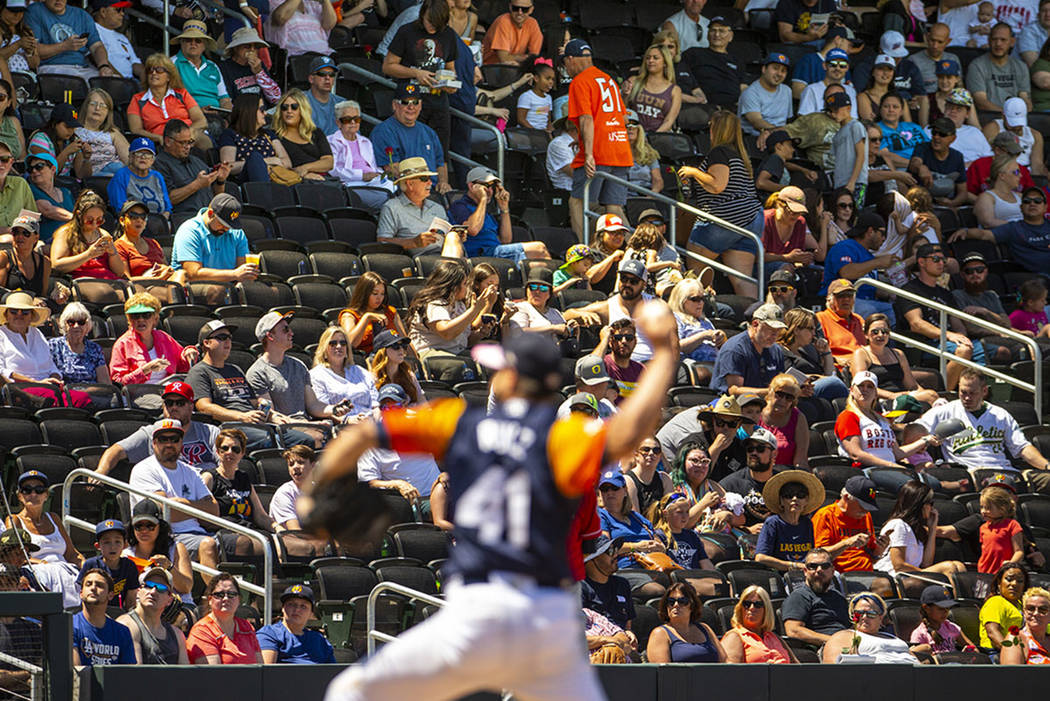 Aviators fans look on as pitcher Norge Ruiz (41) battles the Tacoma Rainiers at the Las Vegas B ...