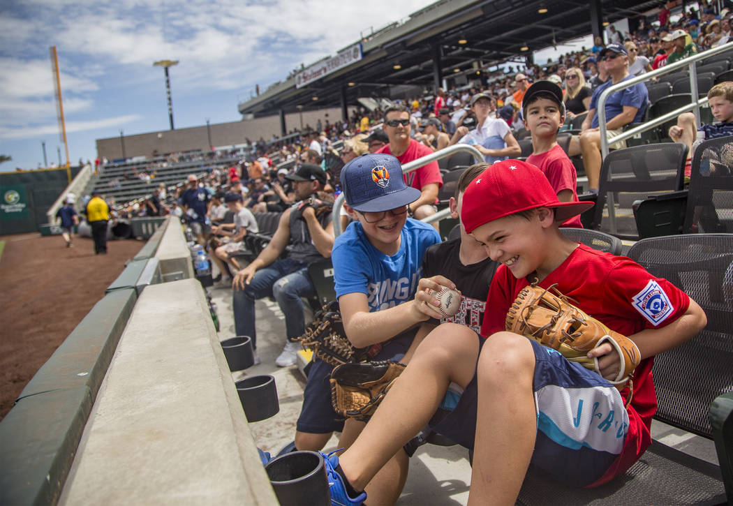 Robby Parker, 11, tries to steal the ball from his friend Jacob Freeman, 10, at the Las Vegas B ...
