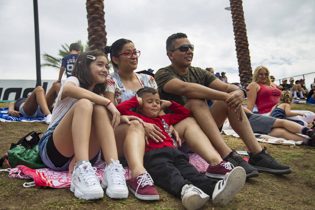 Fridas Rosas, 12, from left, watches the game with her brother Paul Mendoza, 5, and their paren ...