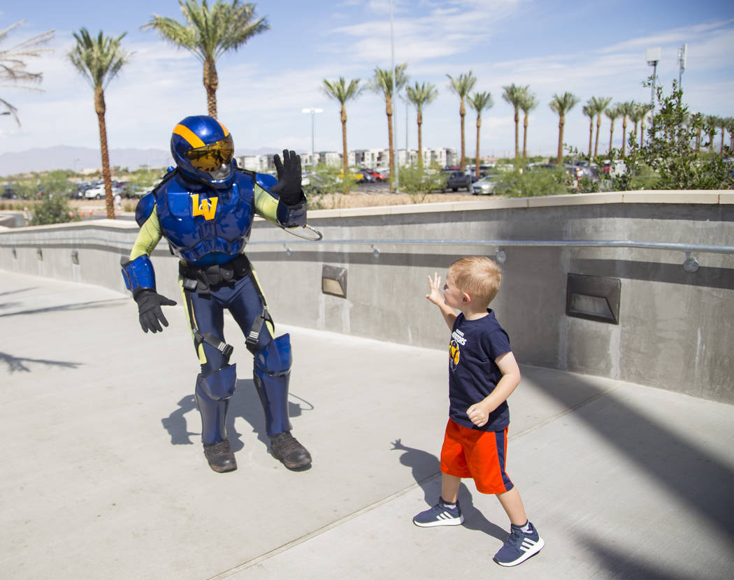 The Aviator mascot prepares to high-five Logan Like, 4, at the Las Vegas Ballpark in Downtown S ...