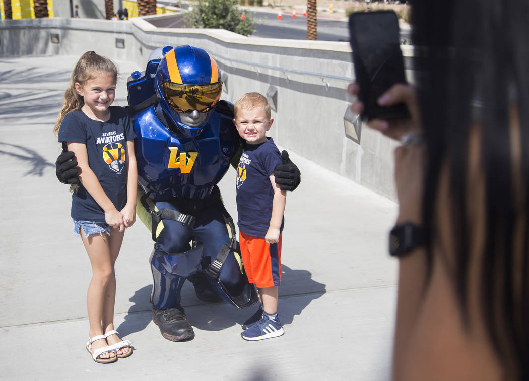 The Aviator mascot takes a photo with Logan Lyke, 4, and his sister Londyn Lyke, 6, at the Las ...