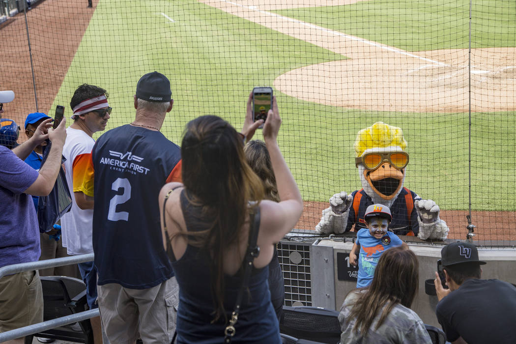 The Spruce the Goose mascot takes photos with fans at the Las Vegas Ballpark in Downtown Summer ...