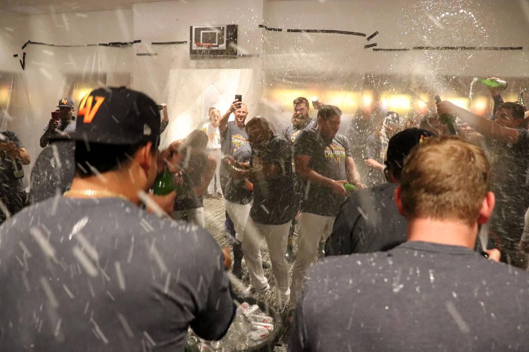 Las Vegas Aviators celebrate in the locker room at the Las Vegas Ballpark in Downtown Summerlin ...