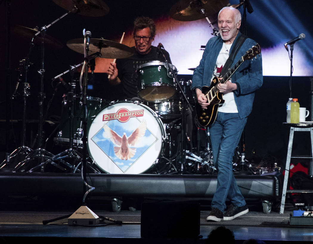 Peter Frampton performs on stage at Ameris Bank Amphitheatre, Sunday, Aug. 11, 2019, in Alphare ...