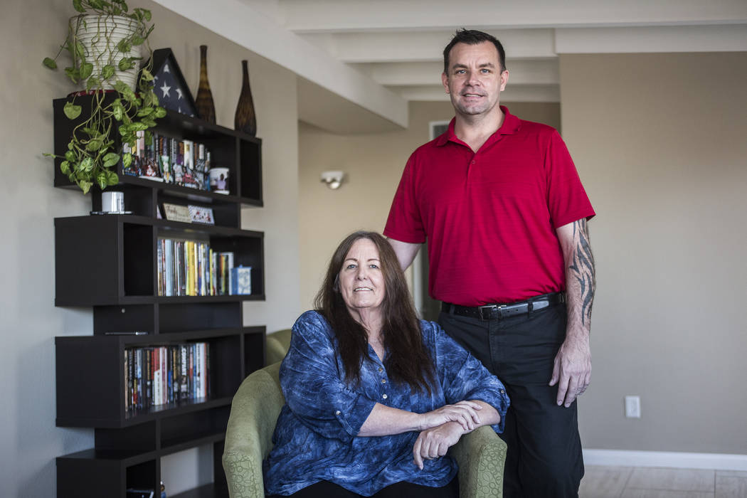 Michael Russell with his mother, Jill Drysdale, at their home in Las Vegas on Jan. 11, 2019. (R ...