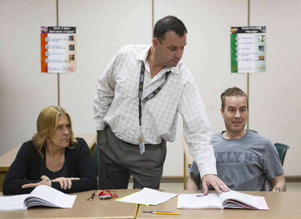 Michael Russell stands by inmates Carrie Kincaid and Andrew Morris as he leads a Moral Recognit ...