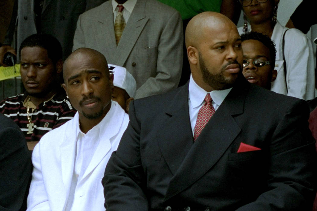 Rapper Tupac Shakur, left, and Death Row Records Chairman Marion Suge Knight, attend a voter re ...