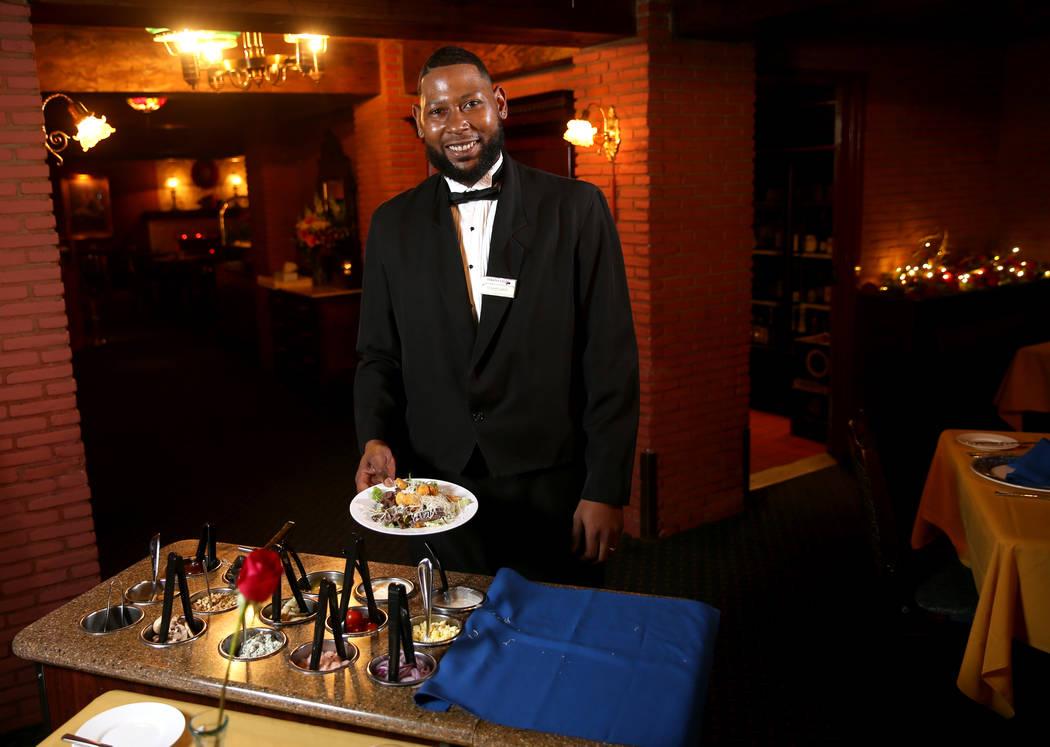 Rashard Miller, 36, of Las Vegas makes a Caesar salad tableside at Hugo's Cellar at Four Queens ...