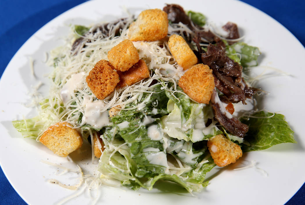 Caesar salad made tableside at Hugo's Cellar at Four Queens in downtown Las Vegas Friday, Aug. ...