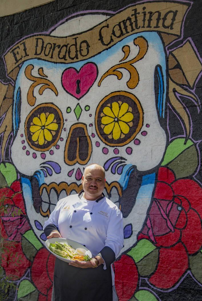 Chef Paco Cortes holds the Tableside Caesar Salad at El Dorado Cantina Restaurant & Bar in ...