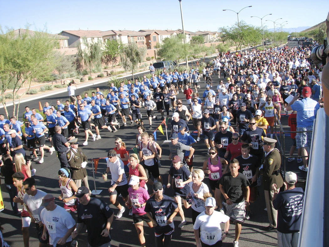 """Runners give it their all in 2010's annual Candlelighters 5K and One Mile """"Race for our Kids."""" ..."""