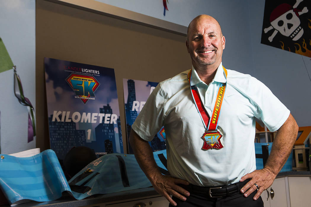 Mark Grenier, who volunteers at the Candlelighters Childhood Cancer Foundation of Nevada, poses ...