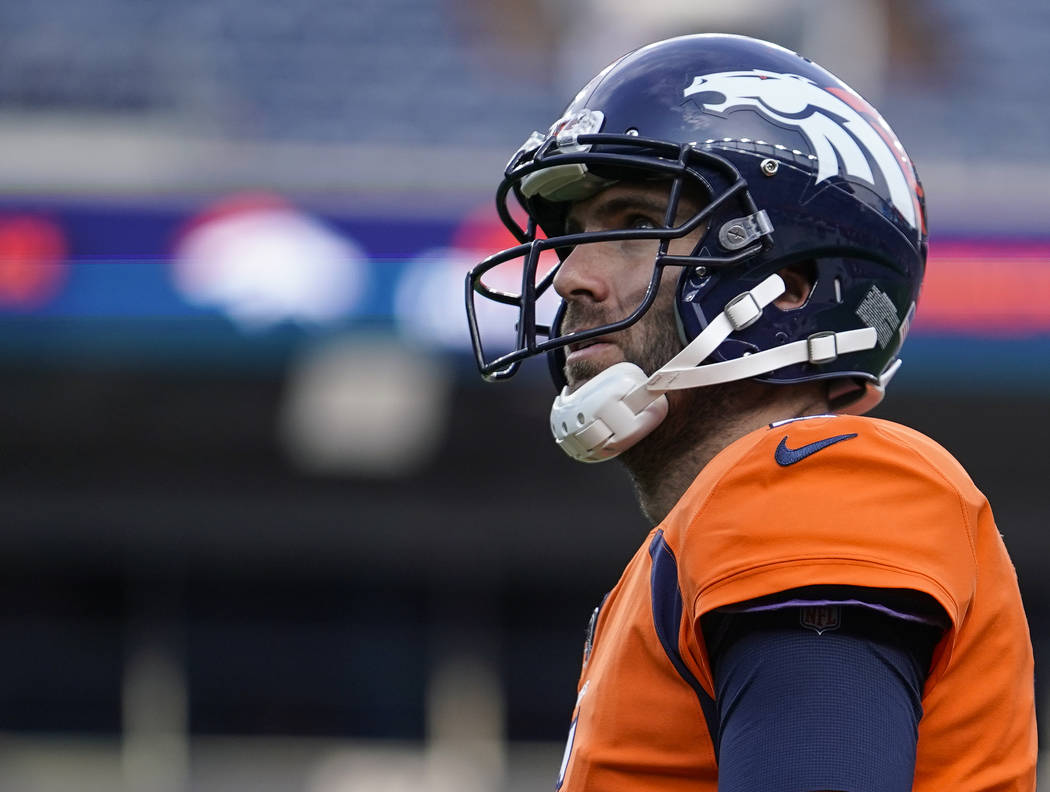 Denver Broncos quarterback Joe Flacco warms up before the start of an NFL preseason football ga ...