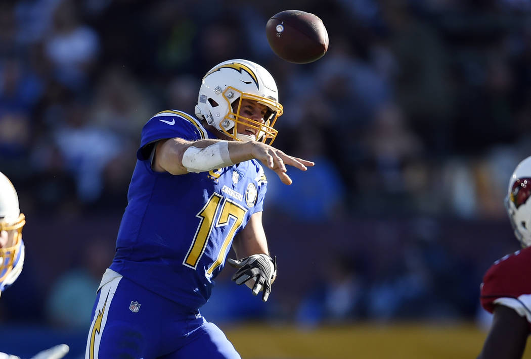 Los Angeles Chargers quarterback Philip Rivers (17) throws against the Arizona Cardinals during ...