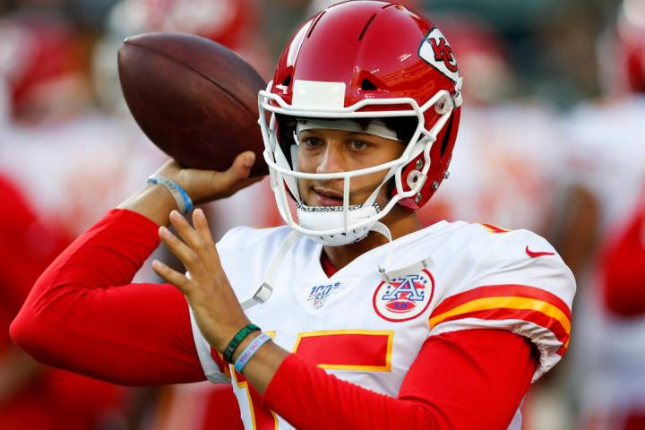 Kansas City Chiefs' Patrick Mahomes warms up before a preseason NFL football game against the G ...