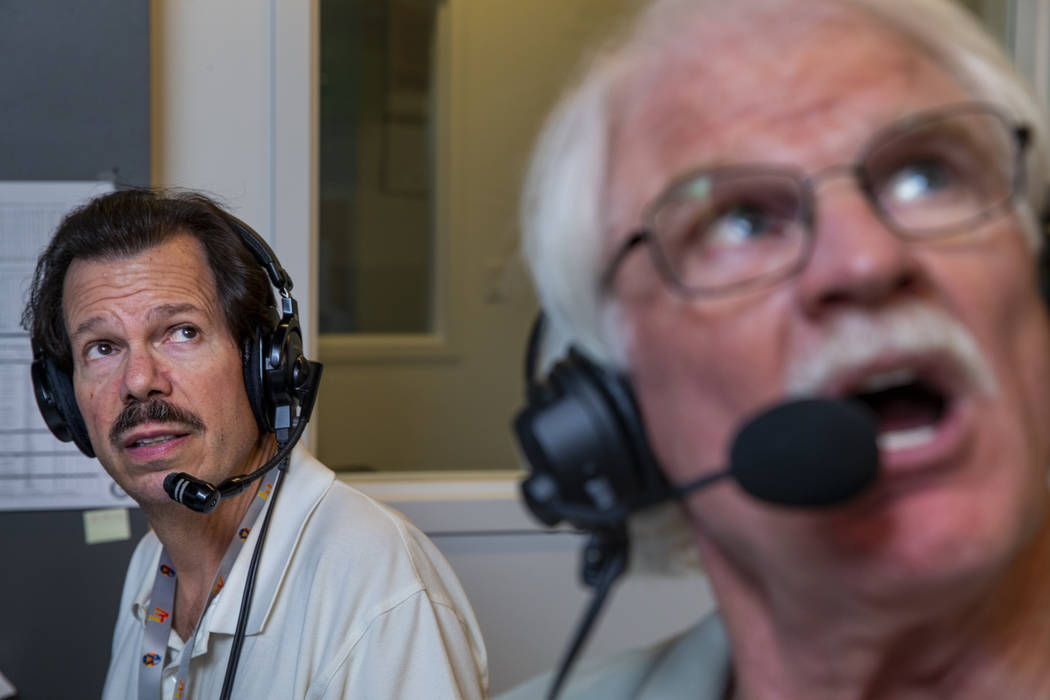 Russ Langer, left, looks on as Jerry Reuss commentates on a replay during their radio broadcast ...