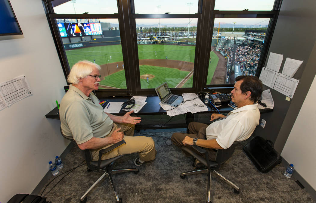 Jerry Reuss, left, and Russ Langer talk baseball on a break in their radio broadcast during the ...