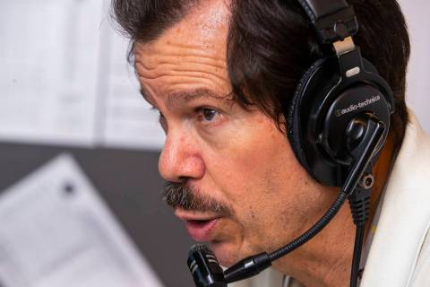 Russ Langer commentates on the play during a radio broadcast for the Las Vegas Aviators game ve ...