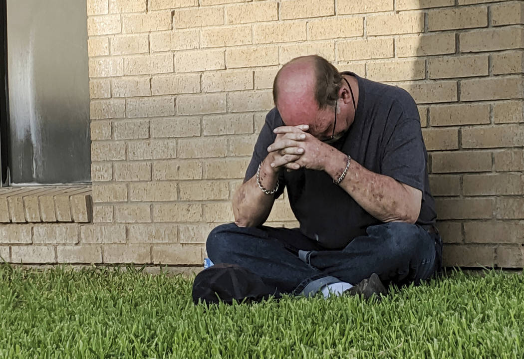 A man prays outside of the Medical Center Hospital Emergency room in Odessa, Texas, Saturday, A ...