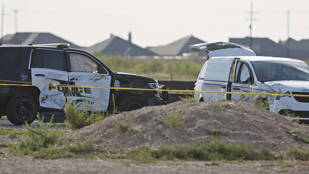A city of Odessa police car, left, and a U.S. mail vehicle, right, which were involved in Satur ...