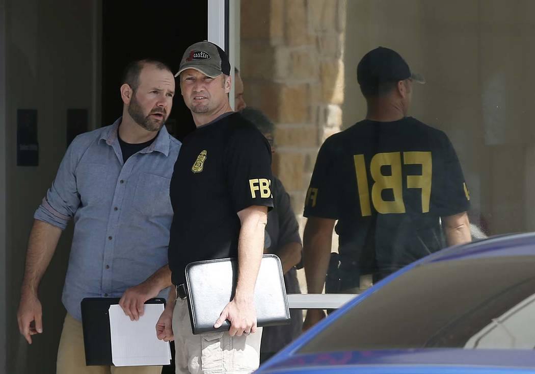 Law enforcement officials investigate Saturday's shooting at a shopping center Sunday, Sept. 1, ...