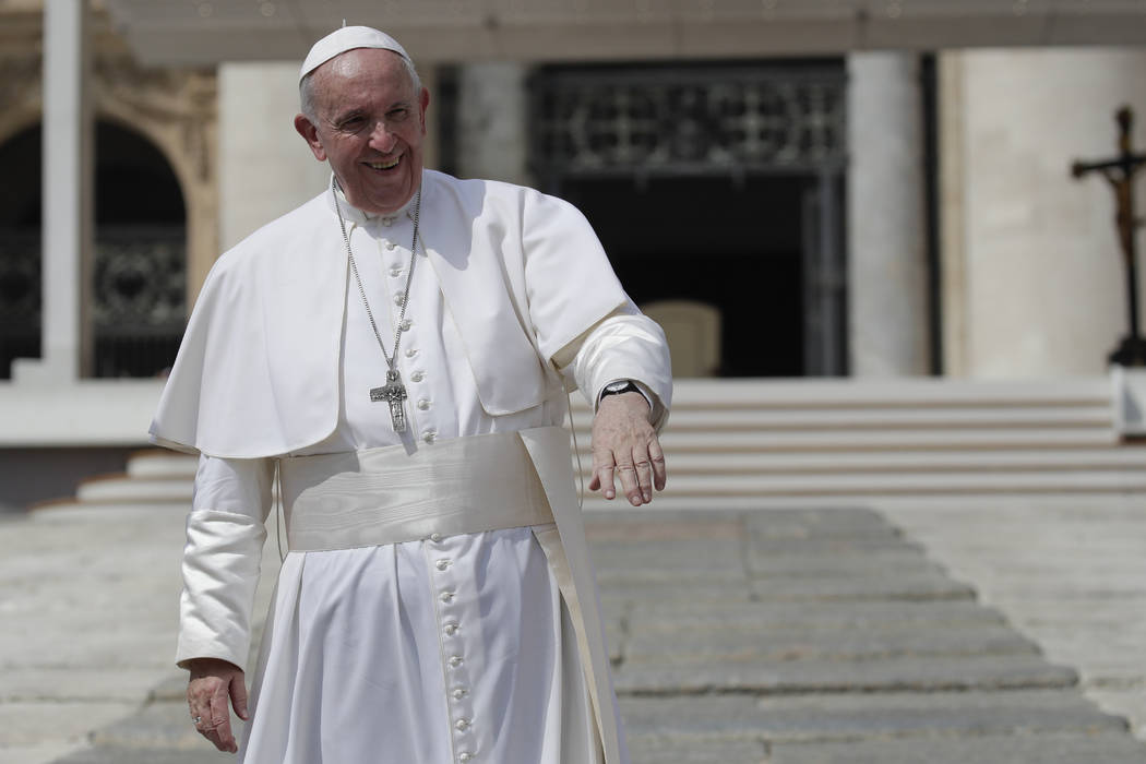 Pope Francis salutes pilgrims and faithful as he leaves St. Peter's Square at the Vatican after ...