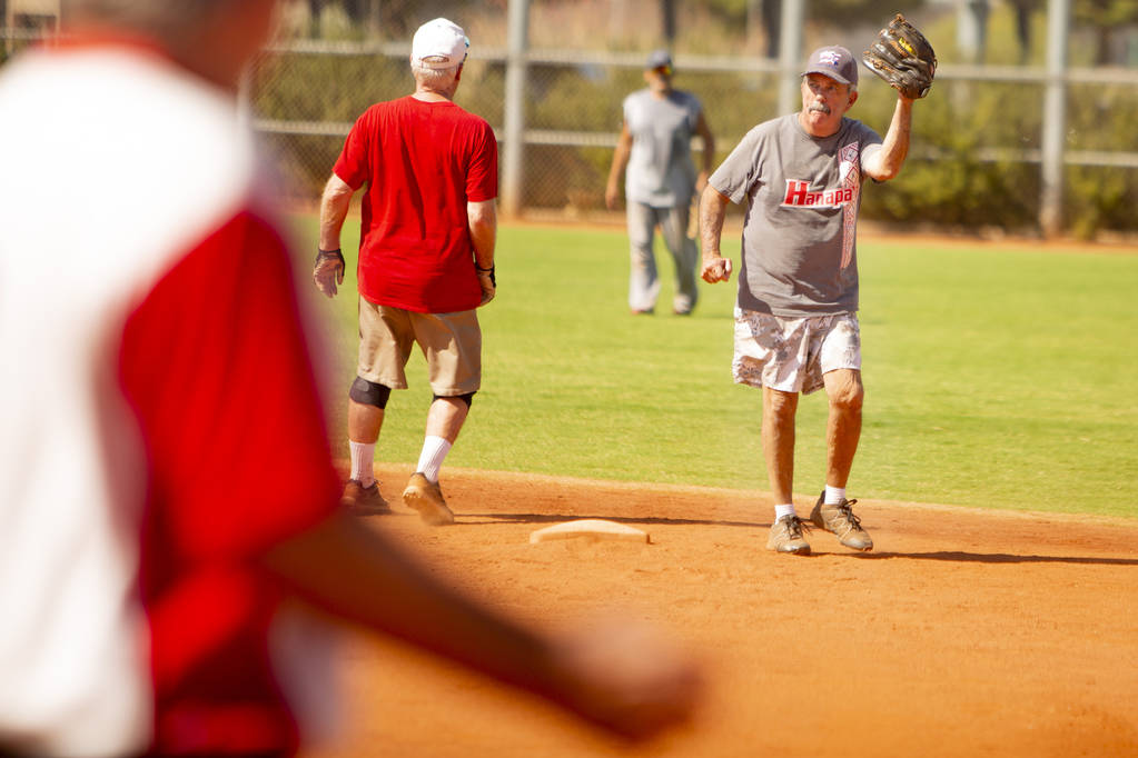 George Fernandez, 76, signals to the pitcher after he makes a catch at Lorenzi Park on Tuesday, ...
