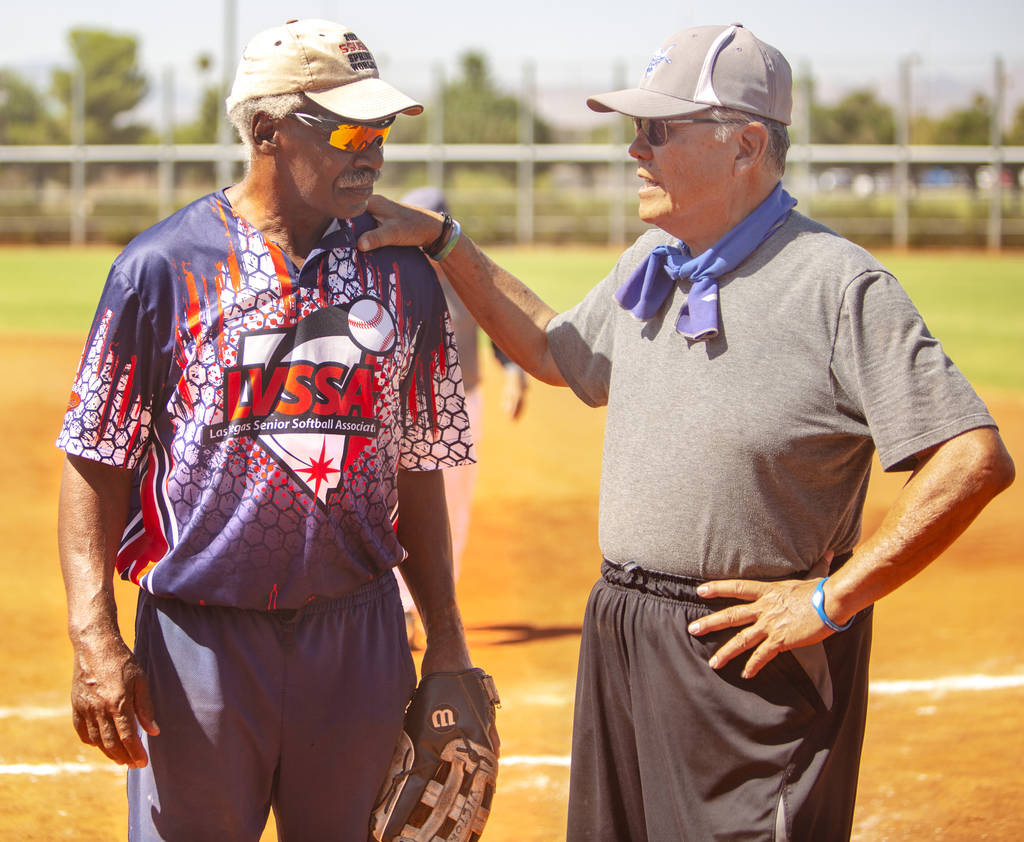 Ken Victory, 79, left, and Robert Tony Ching, 70, right, discuss a play during a baseball game ...