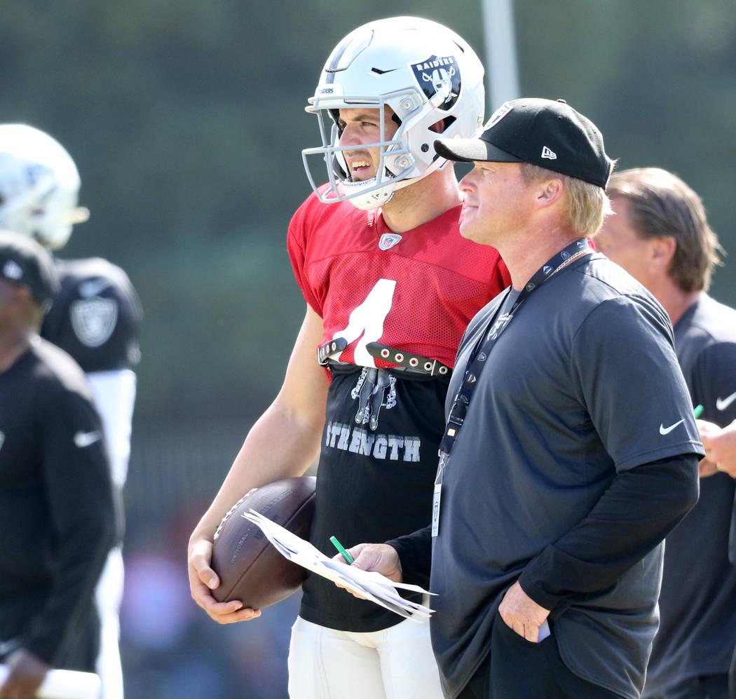 Oakland Raiders quarterback Derek Carr (4) and head coach Jon Gruden watch the offense run a pl ...