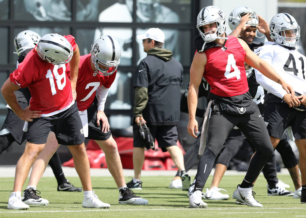 Oakland Raiders quarterback, from left, Nathan Peterman (18), Mike Glennon (7) and Derek Carr ( ...