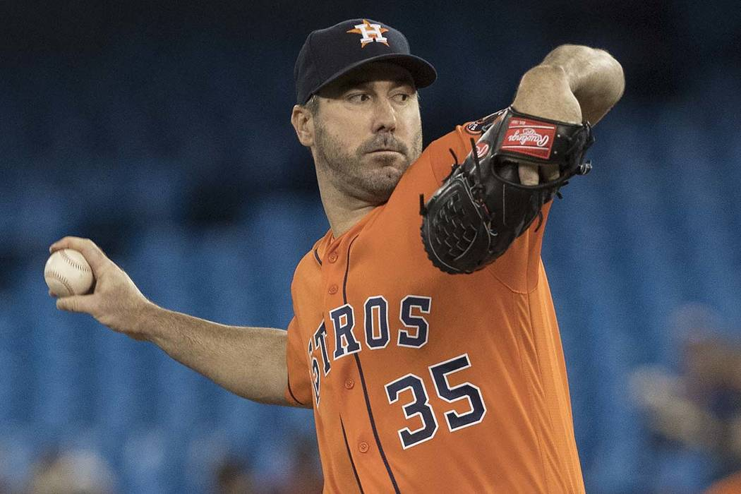 Houston Astros starting pitcher Justin Verlander throws against the Toronto Blue Jays during th ...