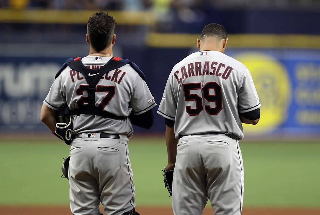 Cleveland Indians pitcher Carlos Carrasco (59) stands with catcher Kevin Plawecki during the pl ...