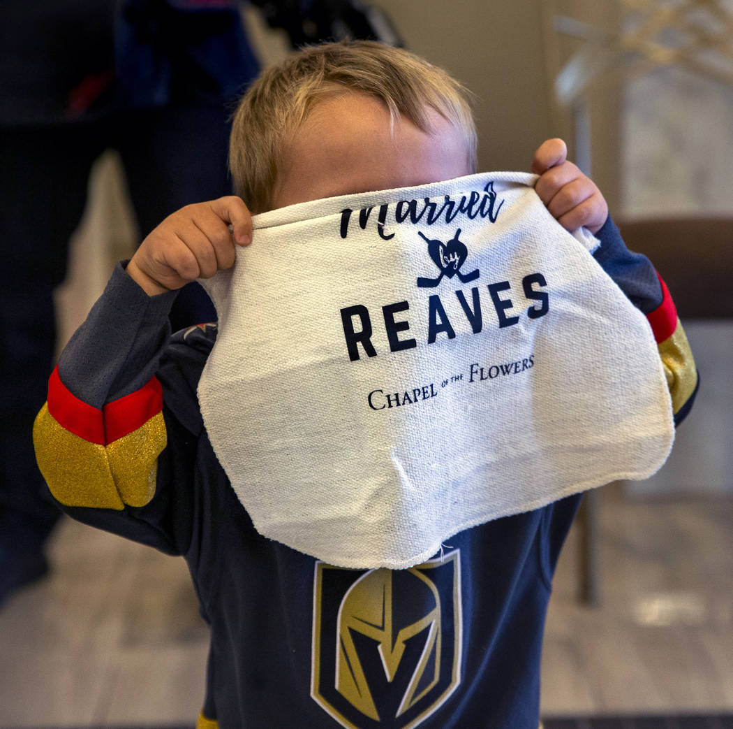 J.J. Long, 2, holds a ceremonial battle towel over his face as Vegas Golden Knights player Ryan ...