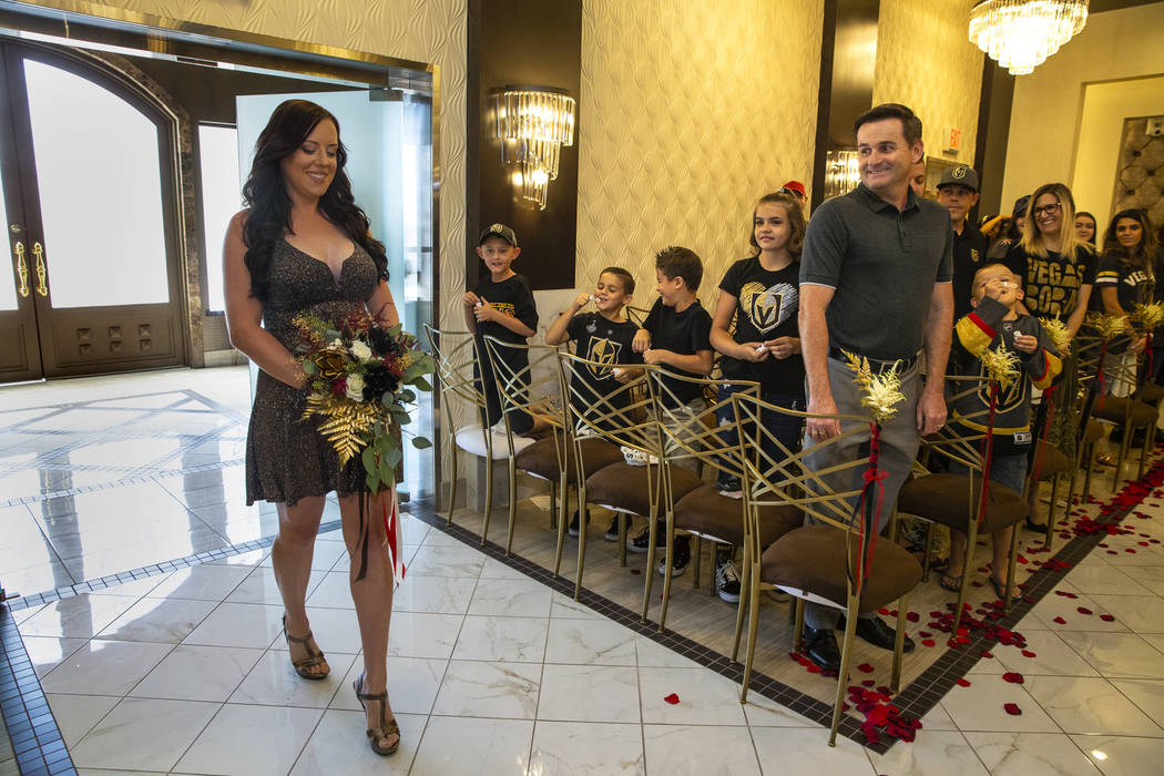 Bride Laura Long enters the chapel as Vegas Golden Knights player Ryan Reaves conducts a marria ...