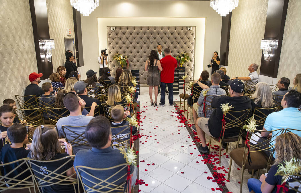 Vegas Golden Knights player Ryan Reaves conducts a marriage vows renewal ceremony for Laura and ...