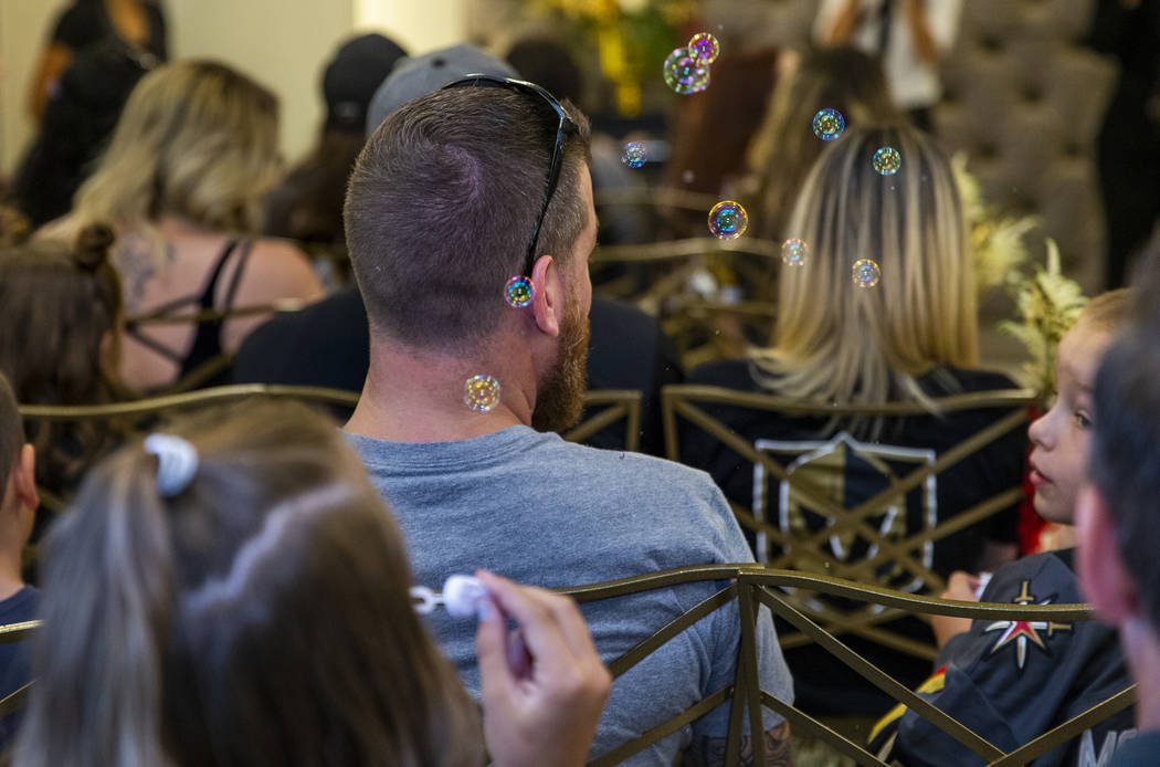 Bubbles are blown by a young guests as Vegas Golden Knights player Ryan Reaves conducts a marri ...