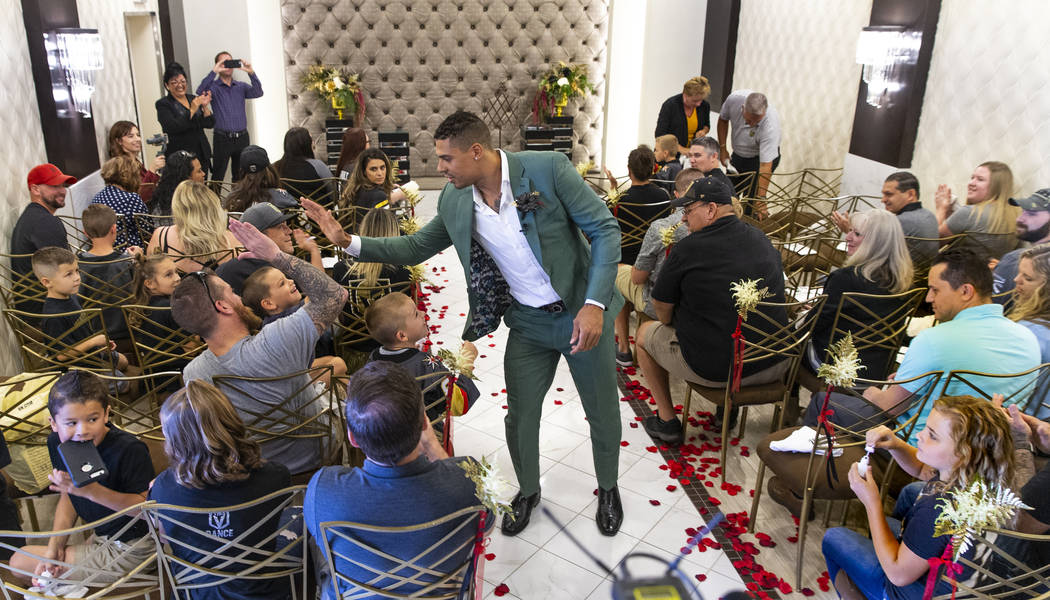 "Vegas Golden Knights player Ryan Reaves walks back down the aisle giving out ""high fives&q ..."