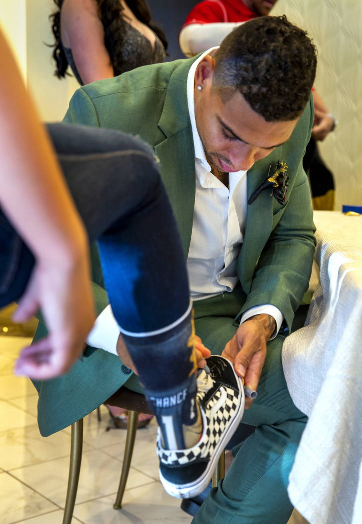 Vegas Golden Knights player Ryan Reaves autographs a sneaker for a guest after conducting a mar ...